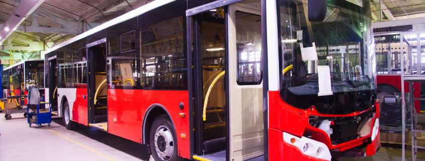 red bus in manufacture with adhesives and sealants for bus assembly